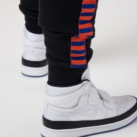Type Pants Mitchell & Ness NBA New York Knicks Taped Fleece Joggers